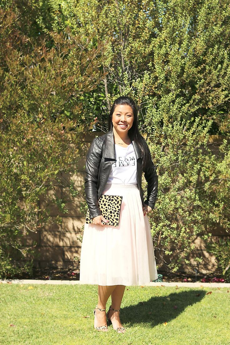 I don't think anything could make you feel more girly than wearing a tulle skirt. It's so feminine, but add a moto jacket and it gives you a little edge. Loving this tulle skirt, graphic tee and moto jacket look. And the leopard clutch and heels, just makes me head over heels for this outfit.
