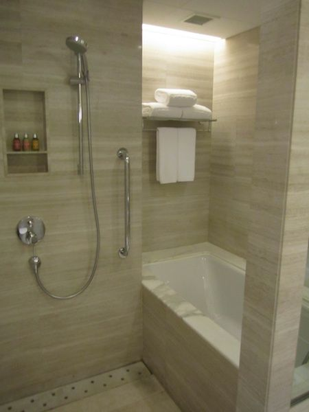TUB IN WITH SHOWER | The Asian-style shower suite contained both a small  deep
