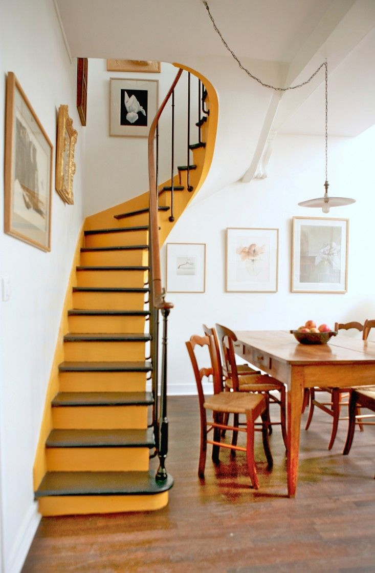 Caribbean Yellow stairs in a Paris pied-a-terre by Ishka Designs of Brooklyn
