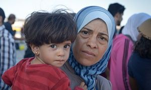 A Syrian woman with her child at the port of Piraeus, Greece.