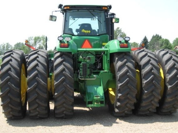 Can you guess how many tyres there are on this giant John Deere tractor? See other John Deere farm tractors at http://www.agriaffaires.co.uk/used/1/farm-tractor.html