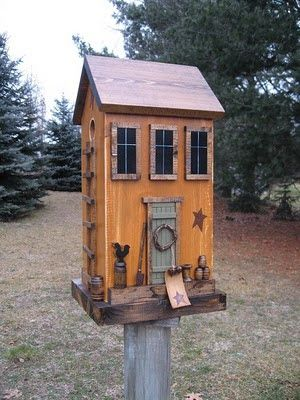 Folk Art Primitive Saltbox Birdhouse- Harmons Country Crafts This birdhouse is fully functional with a lift-up backside with *knob* for easy clean-outs. Spar-urathaned for weather protection. Measurements – 19″ H x 9 3/4″ W x 8.5″ D. Painted a beautiful harvest gold. The roof and bottom and all trimmings are a dark rich walnut stain.