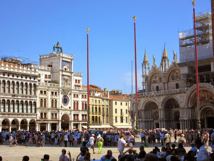 Piazza San Marco, with St. Mark's Clock Tower (left) and St. Mark's Basilica (right) http://destinationfiction.blogspot.ca/2014/10/dan-browns-inferno-more-venice-in-photos.html