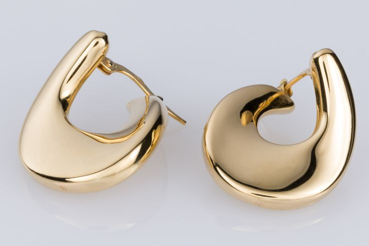 High polish 9k yellow gold swirl hoop earrings. Look so good, they start at the front of the lobe and swing around to the back. Check them out on www.1stdibs.com - The Jewellery Trading Company
