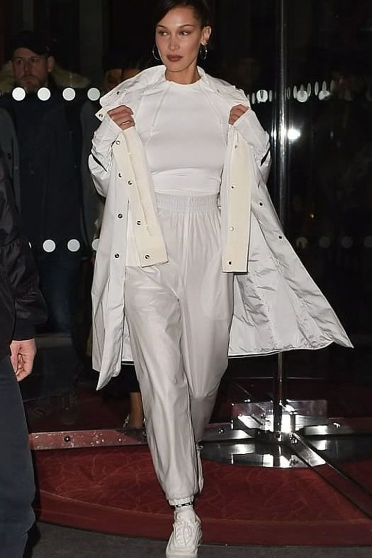Bella Hadid steps out in a white Moncler jacket and Nike Air Max sneakers