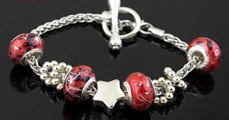 SC123 Handmade silver charm bracelet, on snake chain, with star charms and red porcelain European beads. Normally retails for around $25 each - my selling price (including postage within Australia) is $15.00 each... Please feel free to contact me if your require price for postage overseas…