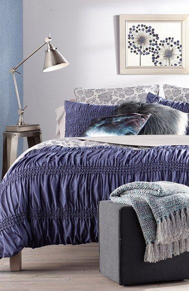 Inspiration for a blue and grey bedroom. Love the mix of patterns and textures.