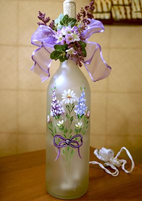 Spring Bouquet Wine Bottle by Tami Carmody As winter finally draws to an end, you can light up Daylight Savings Time with Tami Carmodys Spring Bouquet.  Never fear painting on glass again:  a light touch and a lot of color are the keys to working with enamel.