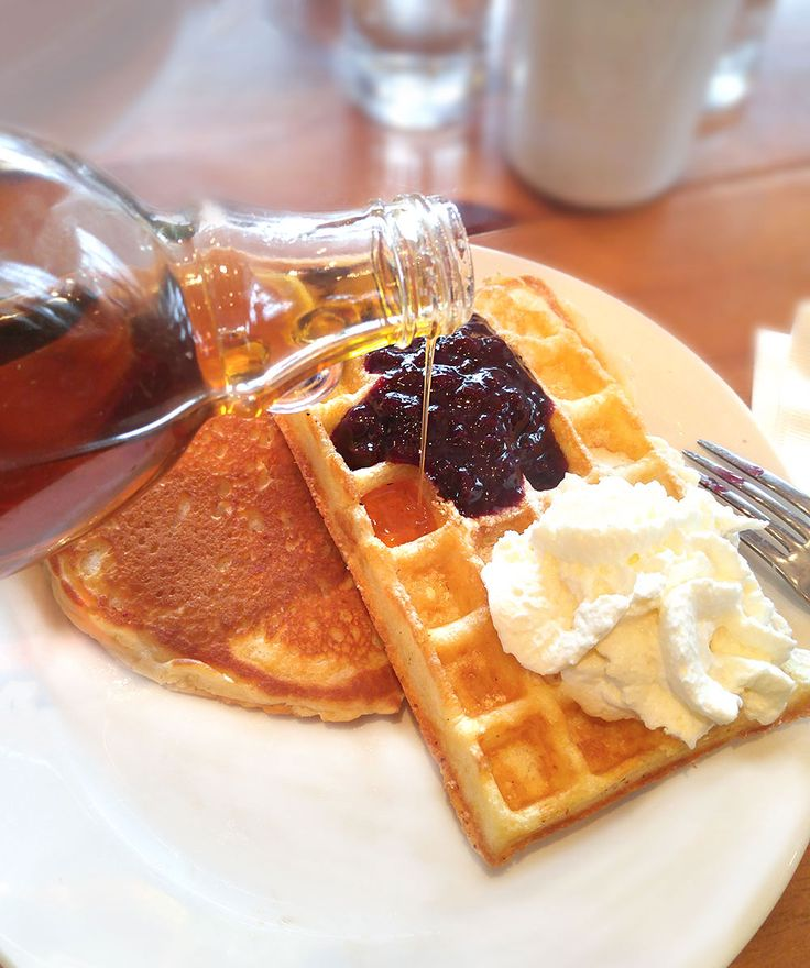 Buttermilk pancake and a Belgian waffle topped with blueberry preserve and maple whipped cream.  Venue: www.templessugarbush.ca  Photo Credit: http://www.stephaniewhite.style/bring-on-the-maple-at-temples-sugar-bush/