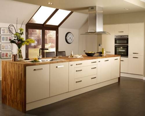Howdens Greenwich Cream kitchen- pale units with a wooden wrap