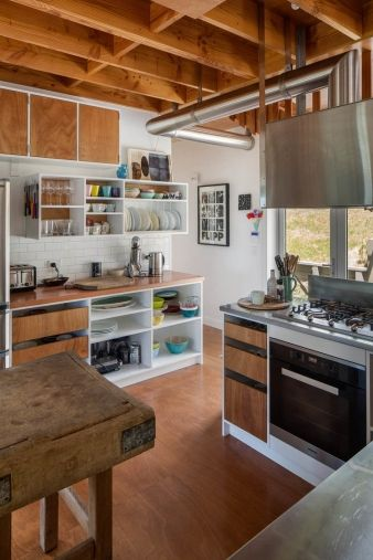 White brick, wood accents and metal meet in the kitchen