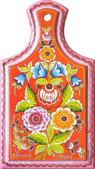 Folk Gorodets painting from Russia. A floral pattern on the wooden chopping…
