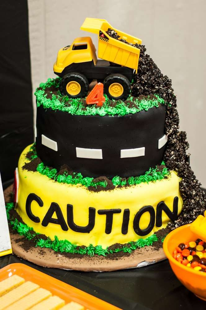 Dump truck cake at a construction birthday party! See more party planning ideas at CatchMyParty.com!