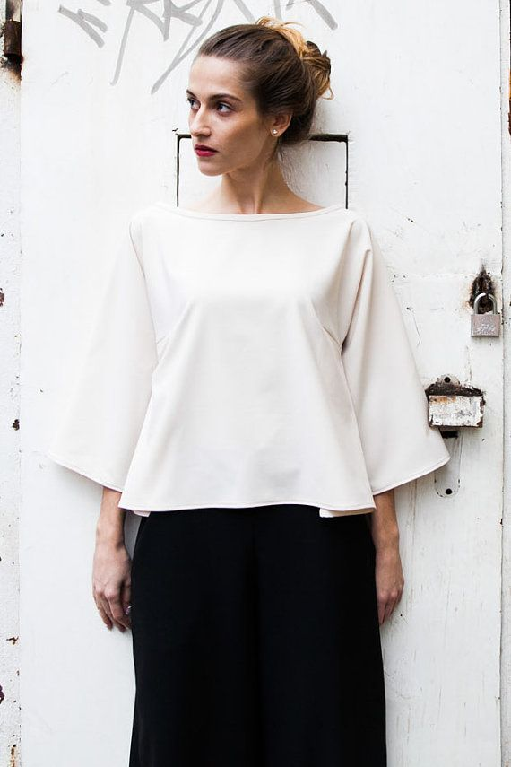 This beige blouse with loose shape gives a perfect sense of comfort. Wide pants or pencil skirt are a perfect match for it. Its made of high quality
