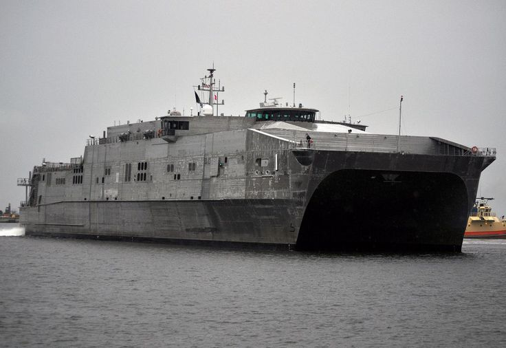 Military Sealift Command Joint High-Speed Vessel USNS Spearhead (JHSV 1) moored to the pier in Puerto Barrios, Guatemala July 22 to commence the offload of gear and personnel in support of Southern Partnership Station 2014 (SPS-JHSV 14).   The Sailors, Marines, soldiers and airmen that make up the adaptive force packages (AFPs) supporting SPS-JHSV 14, disembarked here to start their subject matter expert exchanges (SMEE) with Guatemalan military, government, and health officials.
