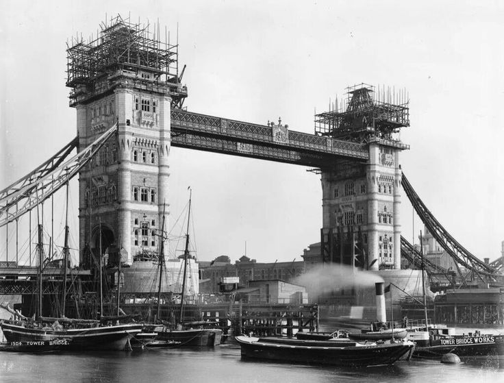 A photo of Tower Bridge taken in 1893. Standing 293ft tall, its two main towers are giant steel frames clad in Portland stone and Cornish granite, in keeping with the neighbouring Tower of London