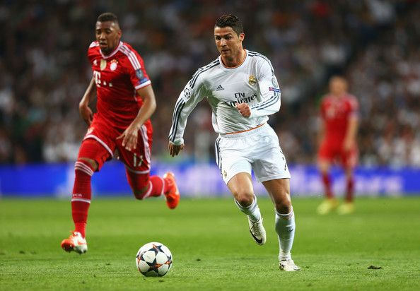 Cristiano Ronaldo of Real Madrid takes on Jerome Boateng of Bayern Muenchen during the UEFA Champions League semi-final first leg match between Real Madrid and FC Bayern Muenchen at the Estadio Santiago Bernabeu on April 23, 2014 in Madrid, Spain.