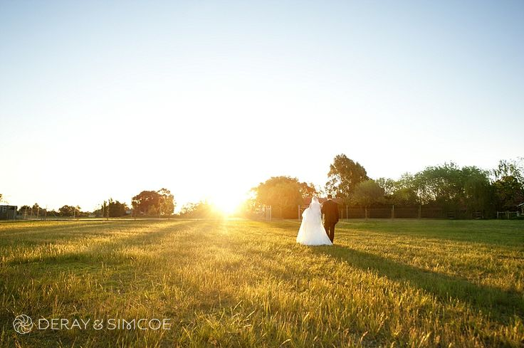 Bride & groom in the sunset at Belvoir Reception Centre, Swan Valley Western Australia Photography by DeRay & Simcoe