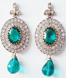 Hand-crafted brass metal cocktail danglers finely studded with cubic zirconia (American diamond) stones.  Size: 55mm x 23mm