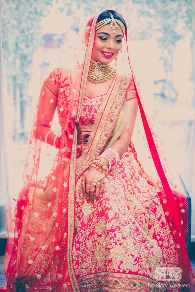 Real Indian Weddings - Aakshi and Siddharth | WedMeGood | Red Bridal Lehenga with Overall Dabka Embroidery and Red Net Dupatta  #wedmegood #indianwedding #indianbride #net #dupatta #gold #lehenga #bridal