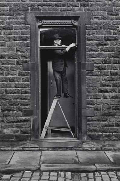 Only in England. Tom Greenwood cleaning 1976 by Martin Parr.