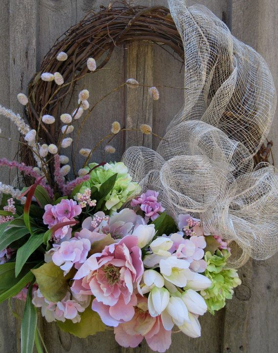 Summer Wreath , Pretty pink geraniums, bright spring green and pale pink ruffle edge peonies along with soft white mini tulips mingle with berries, wildflowers and pussy willows.