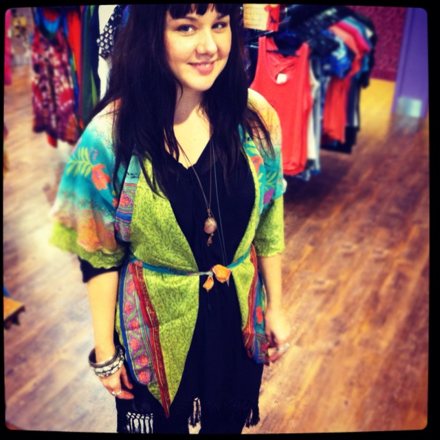 Krystle from Tol Myer with a short sari wrap skirt worn as a kimono style vest. Underneath is a sheer black fringed kaftan.