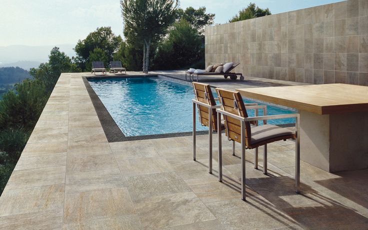 Porcelain tiles might be a good non slip alternative and with a wide range of colours & formats...
