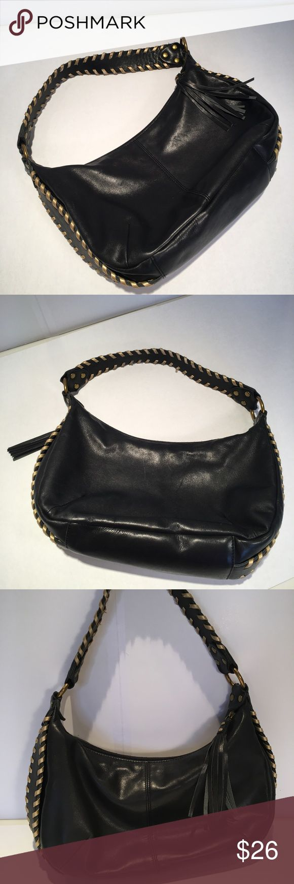 Black Leather Fossil Bag Black Leather Fossil Bag with gold braided trim on shoulder strap and sides of Bag.  There is some wear on the gold leather trim on inside of shoulder strap, but otherwise do not notice.  Bag has one tassle, one zippered pocket inside and 2 open pockets inside.  Good condition. Fossil Bags Hobos