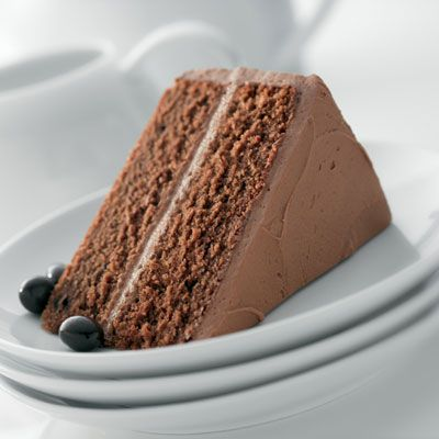 Mocha Buttercream Chocolate Espresso Cake - This moist espresso and chocolate flavored cake is brushed with coffee glaze and then finished with a soft mocha buttercream frosting, making every bite melt in your mouth