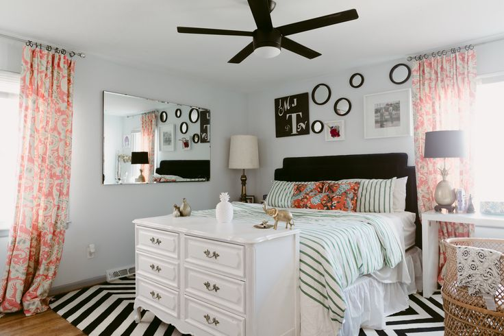 A very happy master bedroom. Vanity table: Ikea (no longer available). Furniture and lamps are from local thrift stores. The bassinet was the thrift store find of the year! Rug was from a local fabric supplier's inventory.