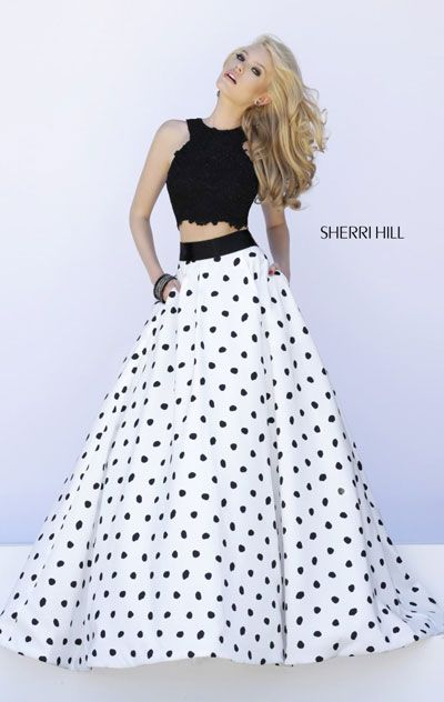 """Dress length: 45"""" (Waist to hem) Shown in: Ivory/Black Be the center of attention in Sherri Hill 32215. This alluring evening gown features haltered neckline. The two piece set is trimmed with fitted bodice. The full ballgown skirt is designed with polka"""