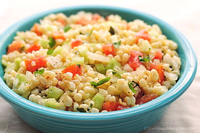 This summery fresh Corn Salad recipe made with sweet corn kernels, chopped cucumber, tomato, and onions all mingled with a zesty dressing is easy to make.