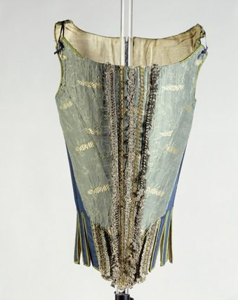 1671-1680 Wool, silk and linen stays. The decorative silk brocade is used only on the front of the stays, as this portion might be visible through the front opening of the gown. The sides and back of the stays are executed in a less costly blue wool and the lining in linen.