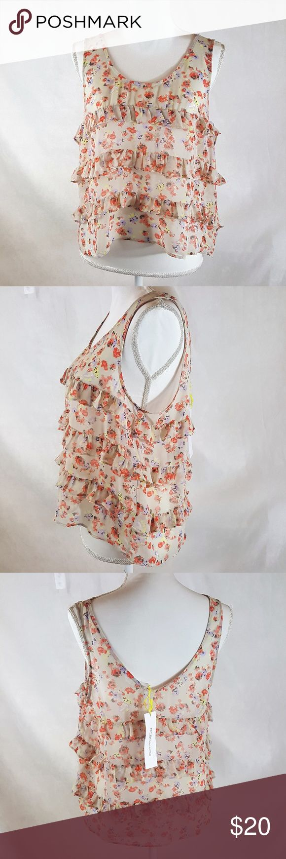 """BCBGeneration  Multi layered ruffle tank NWT Soft floral pattern in a very pretty layered tank (measurements taken flat) •20"""" chest •23"""" length  •Size m •100% polyester BCBGeneration Tops Tank Tops"""