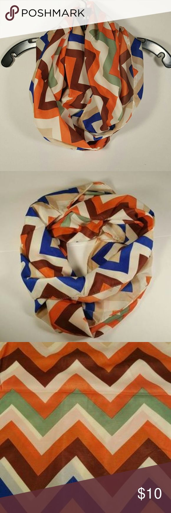"""Colorful Chevron Infinity Scarf Hi Poshers! I'm selling these cute Infinity scarves! The colors are blue, brown, green, orange and beige! Measurements are 17.5""""H and 31""""W lightweight fabric. New in bag Oakley Accessories Scarves & Wraps"""