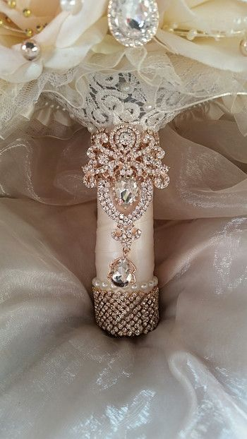 """Custom 9"""" Blush Pink/Gold - $600.00 This listing is for a beautiful custom 9"""" Blush/champagne Ivory mix Flowered Rose Gold Brooch Bouquet This Elegant Bouquet is embellished with beautiful rose gold a"""
