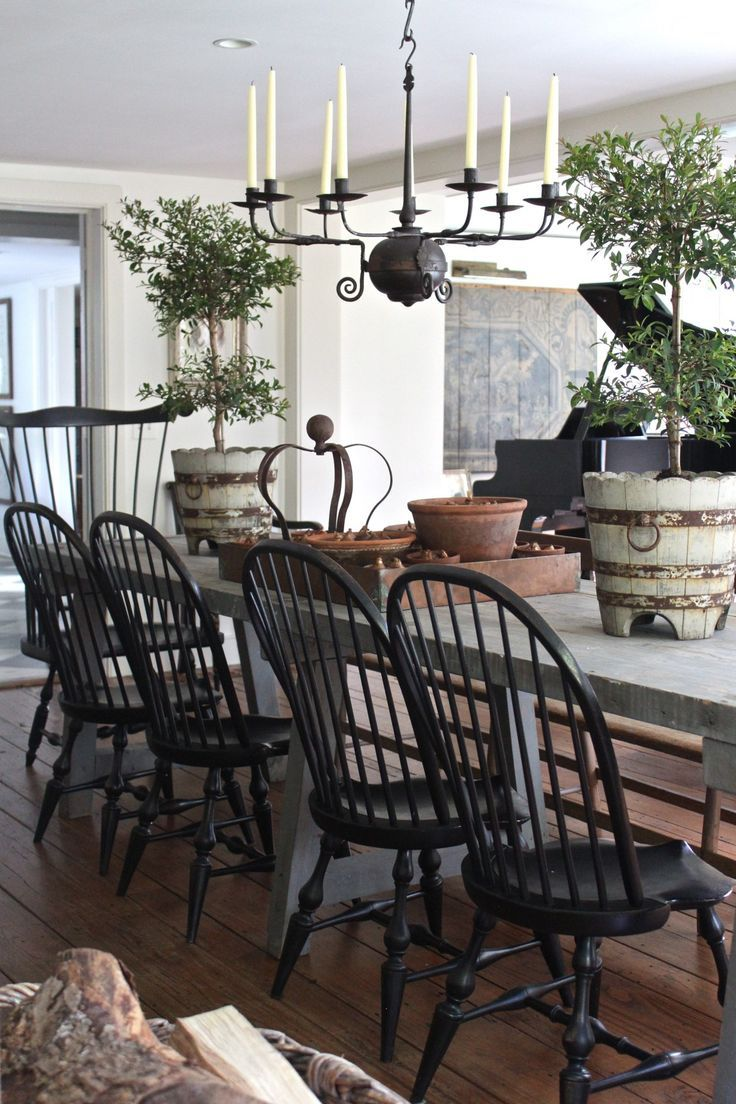 Black farmhouse chairs - Rustic French Table With American Windsors Painted Black And Love The Big Pots