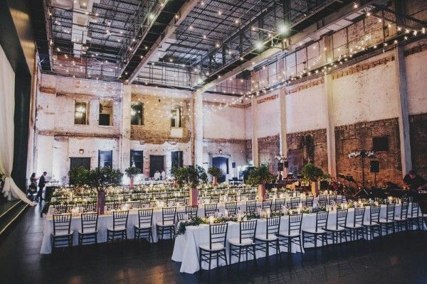 Modern warehouse wedding with greenery touches; the reception.