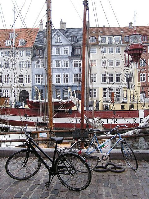 Nyhavn, Copenhagen, Denmark. great place to hang out on a dry day.