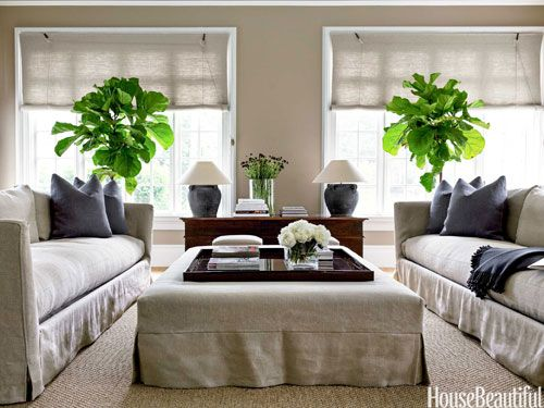 Matching linen ottoman, sofas, window treatments, and even the wall color!