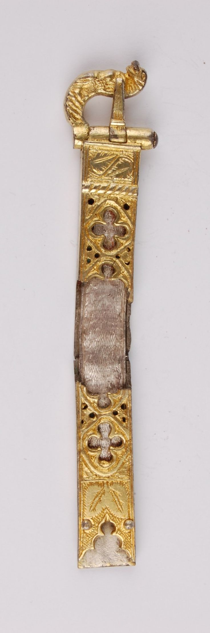 14th - 15th cent Greece, Buckle with plate; silver; the plate engraved with leaves and openwork quatrefoils which reveal a silver strip beneath; one end forms a buckle with a zoomorphic tongue; at the other end two rivets.