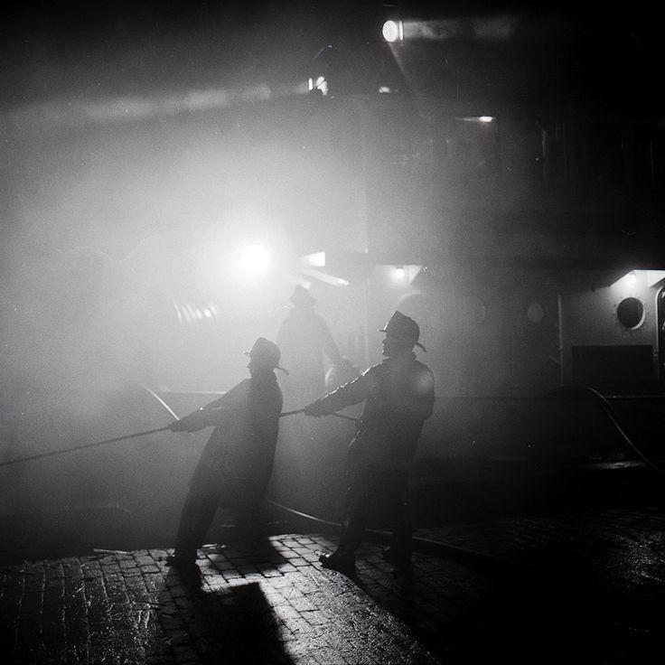 FDNY firefighters operate at a 2-alarm fire on Pier 6, 43rd Street, Brooklyn. Photo taken July 19, 1966.