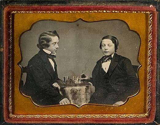 Thought to be a young Paul Morphy v unidentified opponent. Feel free to comment. It certainly looks like Morphy's distinctive hair style. A Facinating picture !!