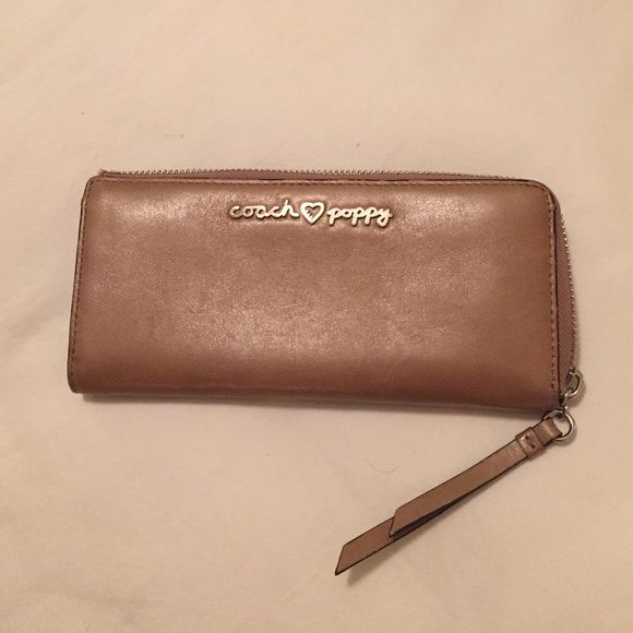 Coach Poppy Wallet Authentic Genuine Tan Coach Poppy Slim Zip Accordion Wallet.  Features 8 card slots, 2 Billfold Compartments and center coin section in Multi Stripe. In Great Condition, No scratches, zipper works great, only used a handful of times.  Will work with reasonable offers  Super rare hard to find! Coach Bags Wallets