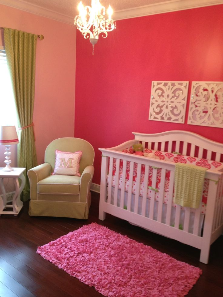 Baby girl nursery accent wall with lighter walls Infant girl room ideas