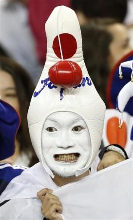 A Japan fan attends the women's first round Group F preliminary soccer match vs South Africa