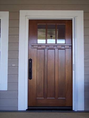 wood front door with white sidelights doors glass and wrought iron exterior wooden craftsman trim