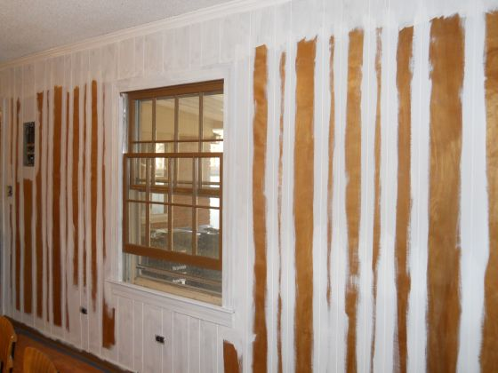 Updating wood paneling-just fill in the cracks with plaster and then paint over...or just paint it