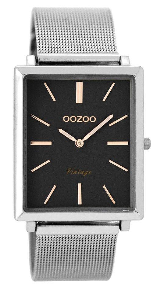 OOZOO Horloge Vintage 31 x 37 mm C8181. Trendy en populair horloge met stalen, zilverkleurige rechthoekige kast. De donkergrijze wijzerplaat is voorzien van rosekleurige index en wijzers. De zilverkleurige, stalen mesh (milanese) horlogeband sluit door middel van een klepsluiting. De rechthoekige kast is 37 mm hoog en 31 mm breed. Trendy en tijdloos model uit de OOZOO vintage-collectie.